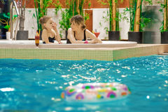 Relaxing in swimming-pool Royalty Free Stock Images