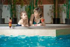 Relaxing in swimming-pool Royalty Free Stock Photo