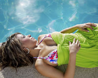Relaxing beside swimming pool Royalty Free Stock Photography