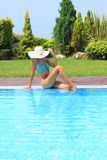 Relaxing by the swimming pool Stock Photography