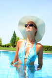 Relaxing by the swimming pool Royalty Free Stock Photography