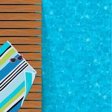 Swimming Pool and Wooden Deck Royalty Free Stock Photos