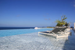 Relaxing Swimming Pool with Gorgeous Scenery of the Sea Royalty Free Stock Image