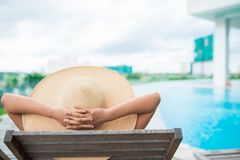 Relaxing by the swimming pool Royalty Free Stock Photo