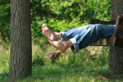 Relaxing in a swing Stock Images