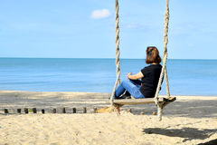 Relaxing on swing at the beach 3 Stock Image