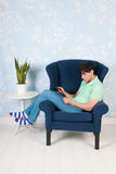 Relaxing with tablet at home Royalty Free Stock Photography