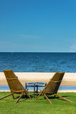 Relaxing Tanning beds on remote beach. Relaxing Tanning beds on remote beach in summer Stock Photography