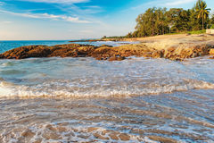 Relaxing on Thai paradise beach with foamy waves. Beautiful seascape with foamy waves on Nang Thong Beach, Andaman Sea, Khao Lak, Thailand. Relaxing on Thai Royalty Free Stock Image