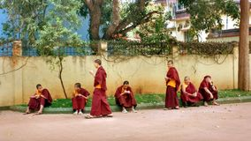Relaxing Tibetan monks in Indian monastery Royalty Free Stock Image