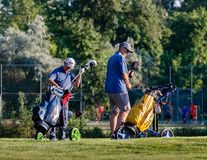 Belgrade, Serbia -June 1, 2019: senior golfers preparing the equipment for the tour. Relaxing time in the afternoon at local golf course, senior golfers stock images