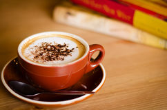 Relaxing Time With A Cup of Coffee. Relaxing time on the coffee break and read the books Stock Photography