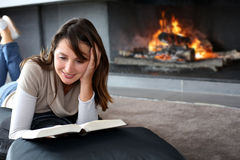Relaxing time by fireplace stock photos