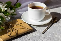 Relaxing time and happiness with cup of tea with among fresh spring flower. royalty free stock images