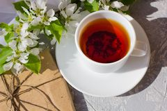 Relaxing time and happiness with cup of tea with among fresh spring flower. stock photos