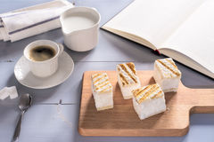 Relaxing time with literature, hot beverage and desserts Royalty Free Stock Photo