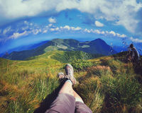 Relaxing time during an outdoor trekking in mountains Royalty Free Stock Photos