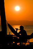 Relaxing Time at Sunset. Man drinking a Beer at Sunset Royalty Free Stock Photography