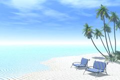 Relaxing together. Two deckchairs on a tropical beach royalty free stock photography