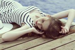 Relaxing trendy girl in summertime Stock Photo