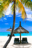 Relaxing tropical holidays with beach chairs over white sandy be Stock Photo