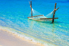 Relaxing tropical holidays with hammock in turquoise water Stock Image