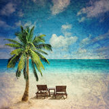 Relaxing under a palm tree Stock Photography