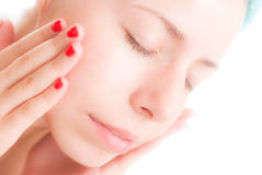 Relaxing and using face cream. Women relaxing after shower using face cream Stock Image
