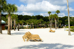 Relaxing vacation. Luxury resort with white sand beach with palm trees stock images