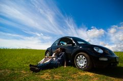Relaxing On Vacation. A couple relaxes while on a road trip Royalty Free Stock Image