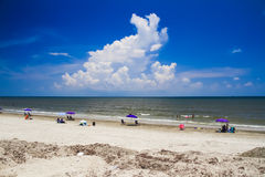 A Relaxing View of the Beautiful Galveston Beach with large Cloud royalty free stock photos