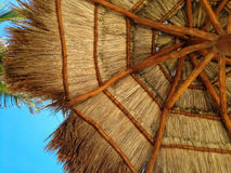 Relaxing View. Looking up at a beach umbrella on a sunny beach Royalty Free Stock Photos