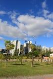 A relaxing view of a neighborhood in Lisbon. A relaxing view of a neighborhood with an airplane in Lisbon Stock Photography