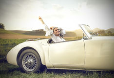 Relaxing in a vintage car Royalty Free Stock Image