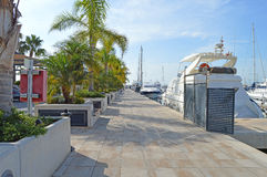 Boats In The Marina - Walkway Near Super Yachts Stock Photo