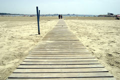 Relaxing Walkway. Walkway leading to golden sands and blue sea royalty free stock images