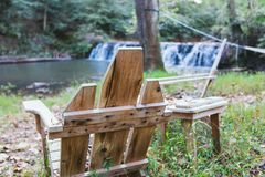 Relaxing by the water. Water fall autumn October Virginia waterfall lovers rental woods chair stock image