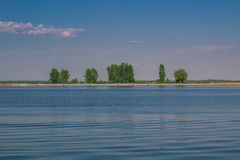 Relaxing water landscape with tree reflections in lake Stock Photography