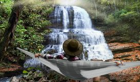 Relaxing by a waterfall Stock Images