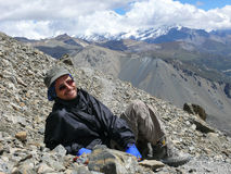 Relaxing on way to Tilicho lake, Chulu in background, Nepal Royalty Free Stock Image