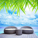 Relaxing wicker sofa beds nearby the sea Stock Photo