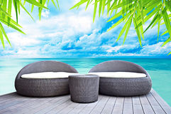 Relaxing wicker sofa beds nearby the sea Royalty Free Stock Photos
