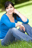 Relaxing woman. Attractive woman relaxing on grass in park Royalty Free Stock Photo