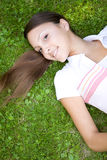 Relaxing woman. Attractive woman relaxing on grass in park Stock Images