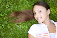 Relaxing woman. Attractive woman relaxing on grass in park Royalty Free Stock Photography