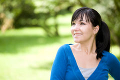 Relaxing woman. Happy young woman relaxing in park Stock Photography