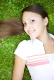 Relaxing woman. Happy young woman relaxing in park Royalty Free Stock Photos