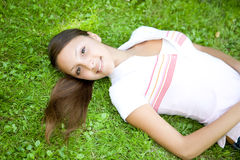 Relaxing woman. Happy young woman relaxing in park Royalty Free Stock Images