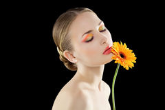 Relaxing Woman. Relaxing Woman with an orange flower Stock Photo