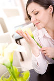 Relaxing woman. Young adult woman with flower at home royalty free stock photos